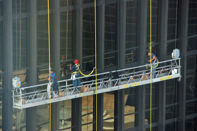 Window washers 30 flights up on the building next to the Adams Mark Hotel.