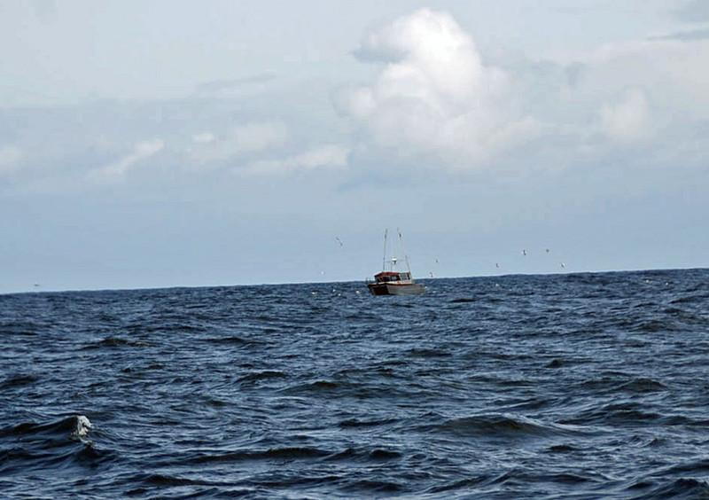 Approaching a crabbing boat.