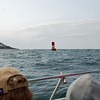 Passing a buoy marking the harbor entrance.