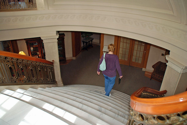 Jean descends the staircase to the first floor of the Pittock Mansion.