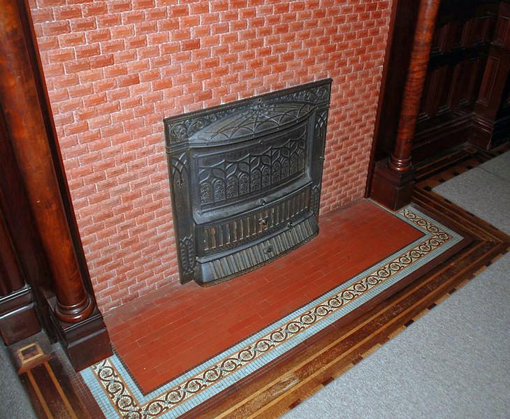 Original tilework at base of fireplace.