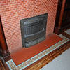 Original tilework at base of fireplace.