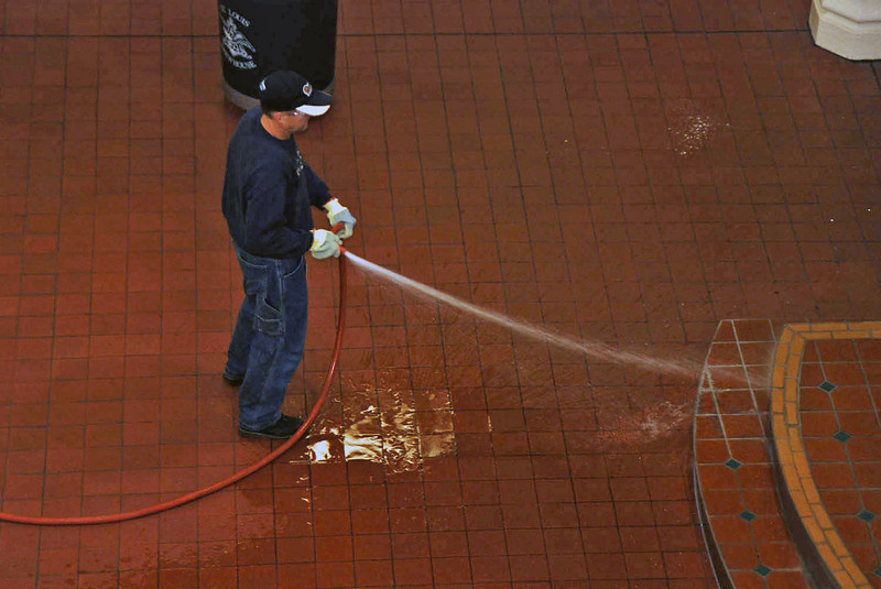 A worker cleaning the area of the mash tanks at the Budweiser Brewery.