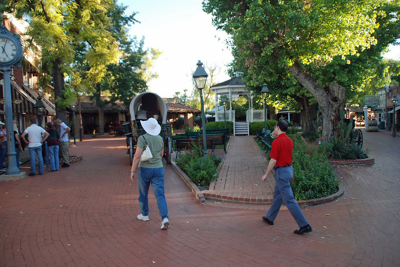 Street scene at the Trail Dust Town, Pinnacle Peak, Tucson, AZ (Jean Finkleman (hat) & Lewis Sloter (red shirt).