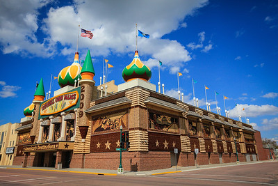 Mitchell Corn Palace; The Corn Palace is a multi-purpose arena/facility located in Mitchell, South Dakota. The Moorish Revival building is decorated with crop art; the murals and designs covering the building are made from corn and other grains.