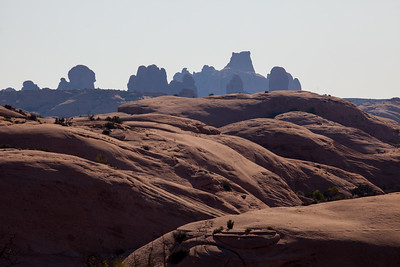 Arches National Park.  These were the petrified dunes.  They had been covered by another layer and salts had seeped through and petrified the dunes.