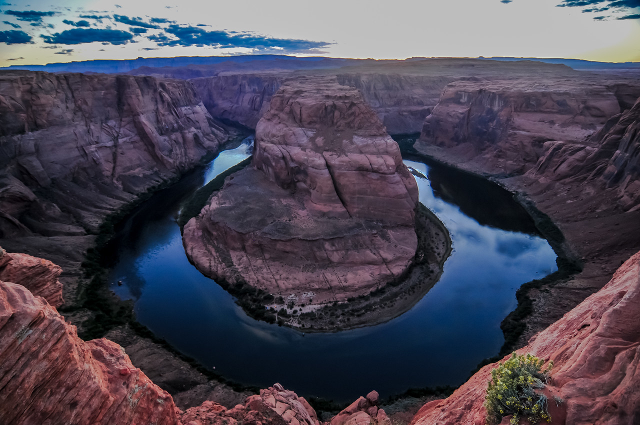 Horseshoe Bend at Dusk with the clouds and the sky reflecting in the river.