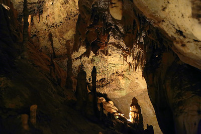 Stalagmites below with sheets of stone (called flowstone) above