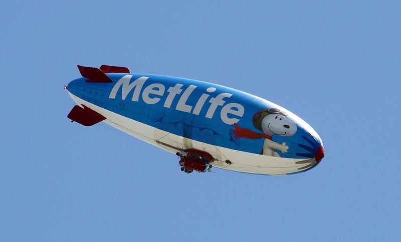 As we drive away, a MetLife blimp flies overhead.