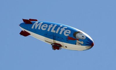 As we drive away, a MetLife blimp flies overhead.