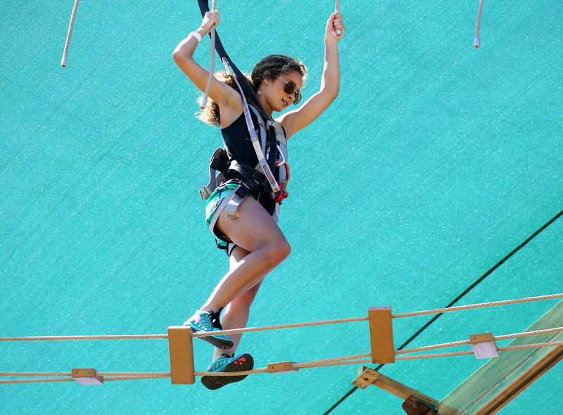 One girl walking on ropes in the Canopy Challenge