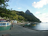 Three minutes walk away, the town pier area has a partial view of the Petit Piton.