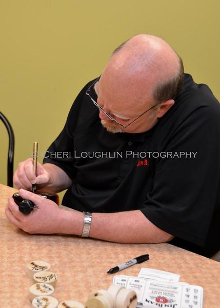 Fred Noe signing Knob Creek Bottle