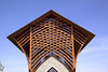 "The structure is made of Western Red Cedar with walls of glass.  The interwoven cedar trusses represent waving wheat in a field for Jesus ""the Bread of Life"""