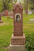 Irmgard Christine Winter monument is a red granite pier with her picture on it.