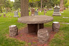 Barbara Evans died of a cerebral hemorrhage in 2000, at the age of 54.  The family chose this design of a round granite picnic table and 4 granite stools to invite people to sit for a while.