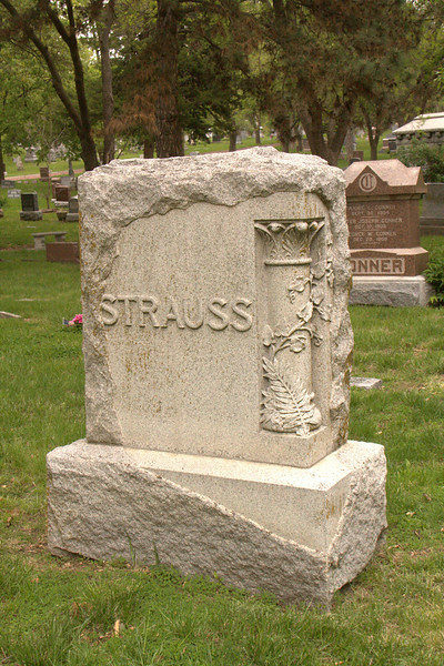 Strauss white limestone marker with decorative column on one corner.