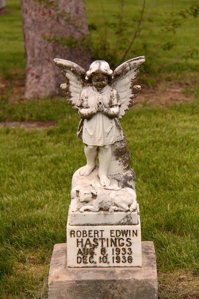 Poignant monument for Robert Edwin Hastings with a child angel with a lamb resting at its feet.<br /> <br /> Born Apr. 6, 1933, Died Dec. 10, 1936