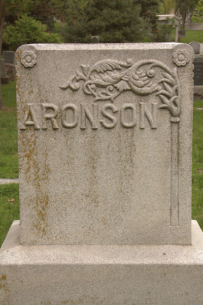 Aronson's white limestone marker caught my eye with the art deco-like relief design.