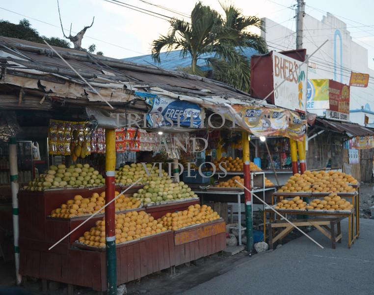 Mango fruit vendors near Bacolod, Negros Occidental, Philippines.