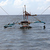 A fishing boat floats along the shore of Omiles, Cauayan, Negros Occidental, Philippines.