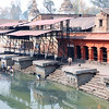Kathmandu, the place where cremations take place. Boys looking for jewelry in the water.