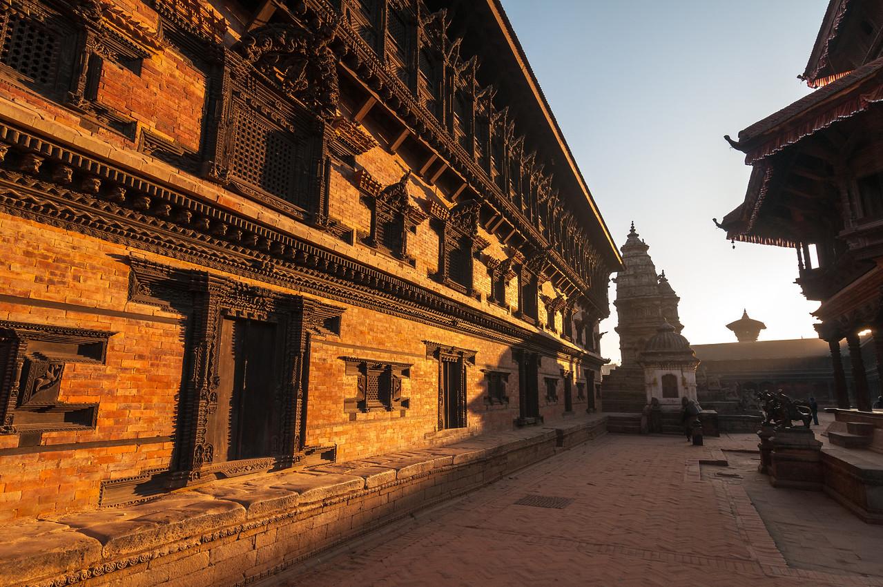 The Palace of 55 Windows glows warm in the sunrise. Durbar Square, Bhaktapur. Nepal