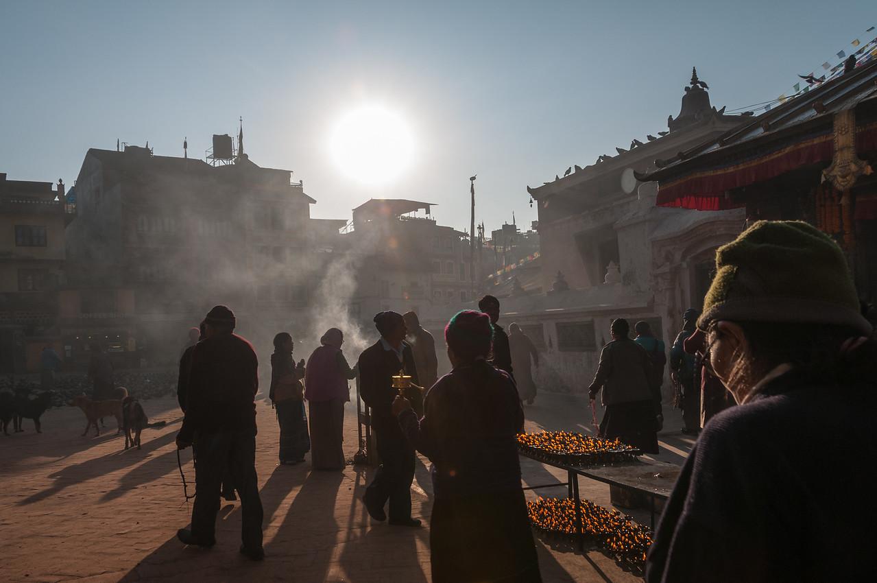 Early morning devotees circle the stupa at Boudha. Nepal