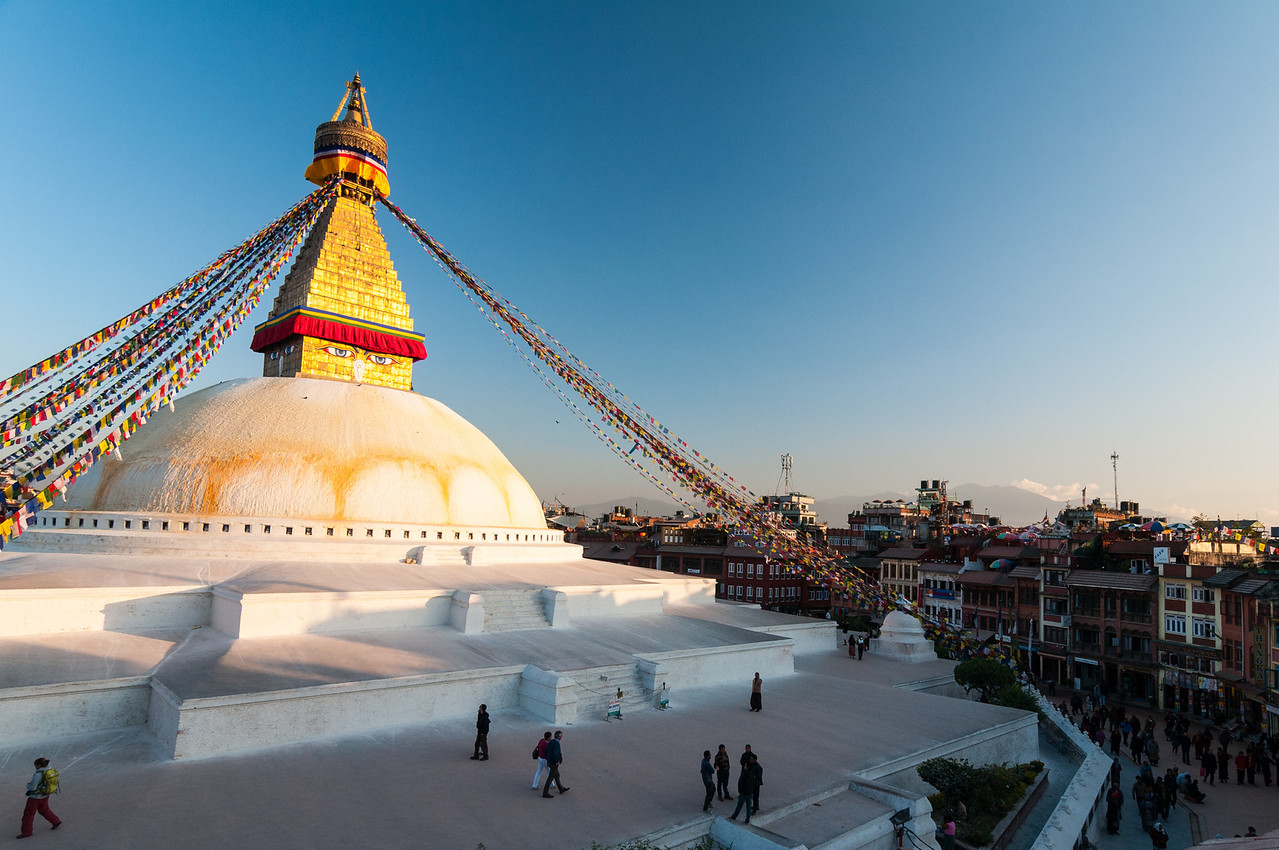 A sense of scale as the sun sets on the stupa at Boudha. Nepal