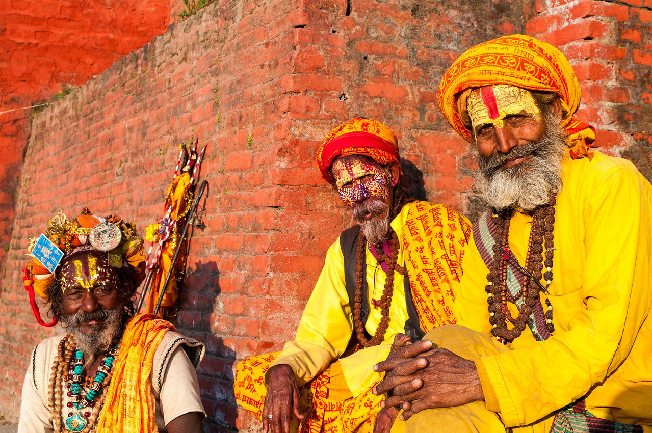 Three Holy men(?) pose for the camera at Pashupatinath. Nepal