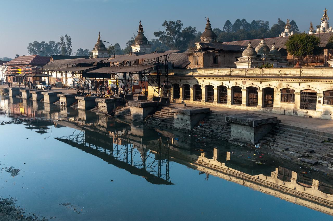 Ram Ghat, reflected in the Bagmati River. Pashupatinath, Nepal