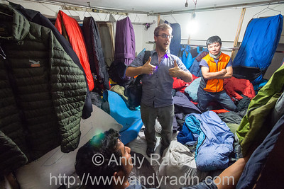 Mike picks through a whole room piled deep with sleeping bags to rent. Kathmandu, Nepal