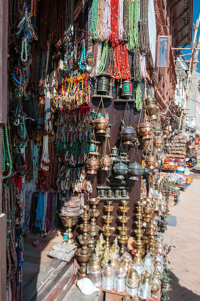 Souvenirs abound in the shops surroundin Boudha's stupa. Boudha, Nepal
