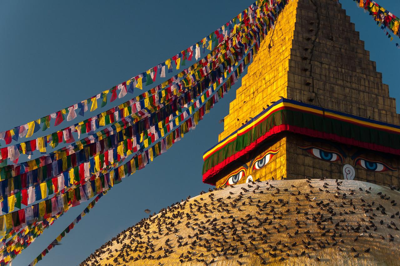 The early morning sun strikes the stupa at Boudha. Nepal