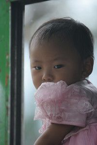 little girl sitting in the bus from Besi Sahar to Bhulbhule