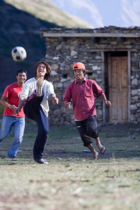 Boys playing soccer in Yak Kharka