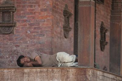 Man sleeping in Durbar Square in Kathmandu