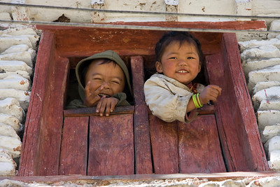 Children looking out the window in Marpha