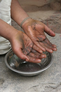 Girl shows her hands black from Hashish