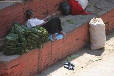 someone selling leaf-bowls at Durbar Square, Kathmandu