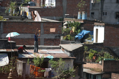 Kids flying kites on rooftops, Kathmandu. Most of them didn't fall.