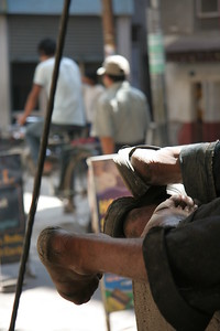 Workers sleeping in Kathmandu (no those are not shoes)
