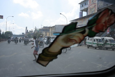 From a taxi in Kathmandu. Do you think the boy made it across?
