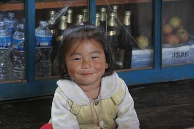 Girl on restaurant floor in Dharapani