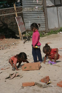 girls playing with roadside trash