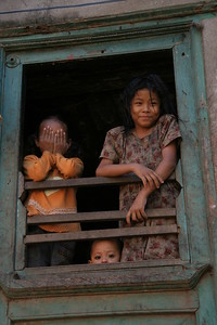 Kids in a window, Kathmandu. Check out the creepy kid at the bottom...