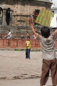 Kids flying kites in Durbar Square, Kathmandu, as part of the festival