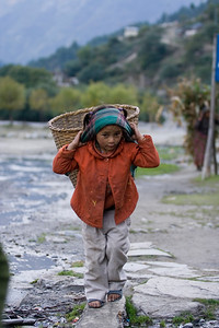A girl carrying good back home in Khobang