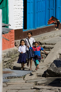 Children on the way to school in Tatopani. One of them was flying