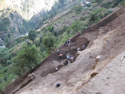 Nepali's building a road by hand